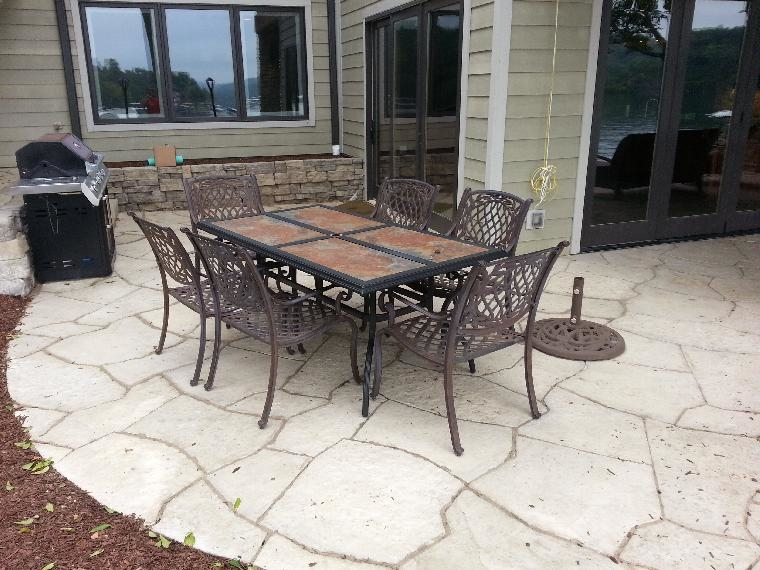Patio furniture sits perfectly on the new Rosetta Grand Flagstone Patio